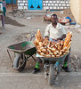 Selling bread in a wheelbarrow