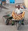 Selling bread in a wheelbarrow