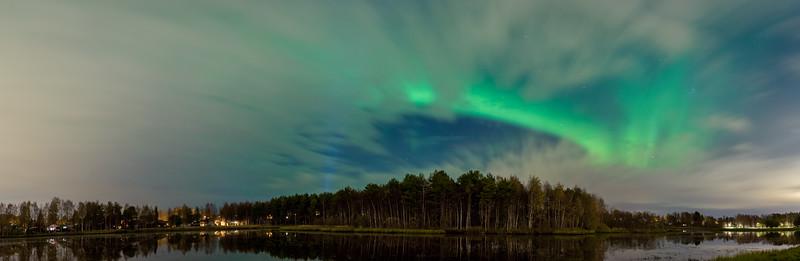 The aurora peeks trough the clouds in Oulu.