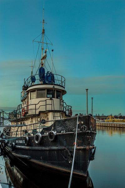 Boat docked in early winter in Oulu, Finland.