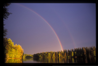 Rainbow over lake, Finland.