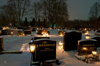 On Christmas Eve, Finns visit cemeteries and light candles at their ancestors' graves. Finland.