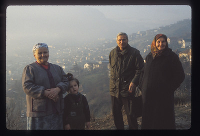 People on a hillside, Muslim cemetery in background, above Sarajevo, Bosnia.
