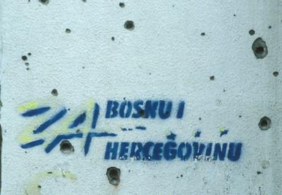 Graffiti with bullet holes, Sarajevo, Bosnia.