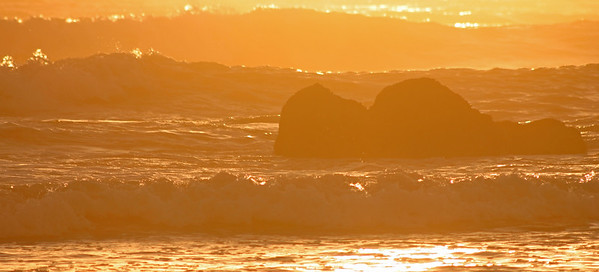 Rocks and waves at sunset