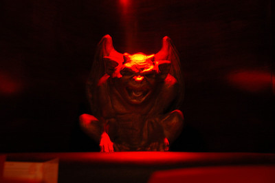 Gargoyle in nightclub, Paris, France.