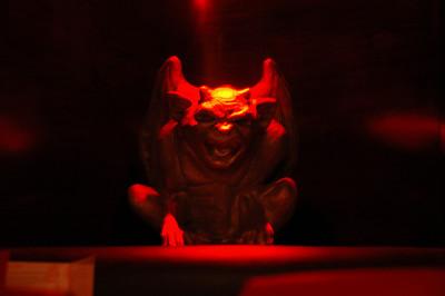 Gargoyle in nightclub, Paris, France.
