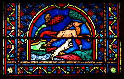 Detail of stained glass, Cathedral of Notre Dame, Paris, France.