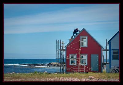 Working on a summer beach cottage, Ile aux Marins, St. Pierre et Miquelon, France d'Outre-Mer.