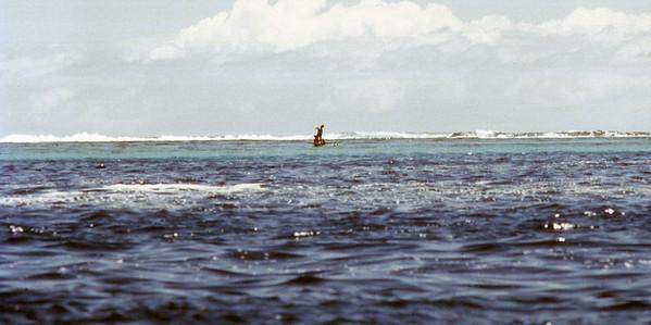 Boys on an outrigger canoe, Moorea, French Polynesia.