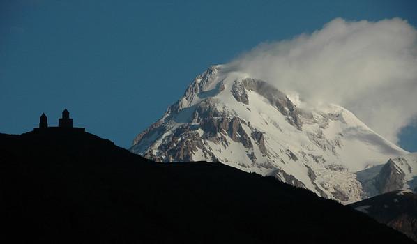 Mt. Kazbek (5033 meters/16512 feet) and 14th century Trinity Church (Tsminda Sameba), Caucasus mountains, Republic of Georgia.