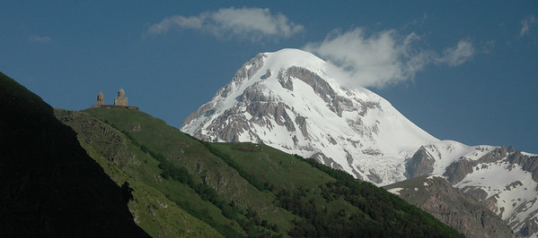 Mt. Kazbek (5033 meters/16512 feet) and 14th century Trinity Church (Tsminda Sameba), Caucasus mountains, Republic of Georgia.