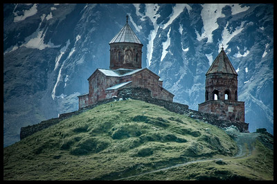 14th century Trinity Church (Tsminda Sameba) near Mt. Kazbegi, Caucasus mountains, Republic of Georgia - HDR.