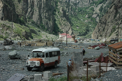 Bus at construction of new customs/immigration border post, Republic of Georgia's border with North Ossetia, Russia.