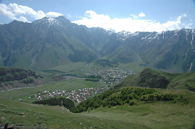 The high Cauacsus mountains, and Kazbegi town, Republic of Georgia.