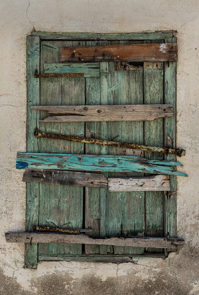 Window of an abandoned building on Lesvos Greece.