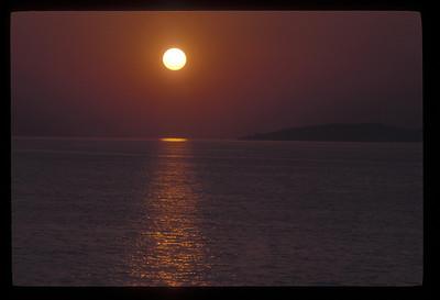 Sunset over the Aegean Sea near Pireaus, Greece.