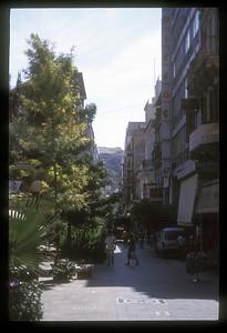 The Parthenon atop the Acropolis and pedestrian area, Athens, Greece.
