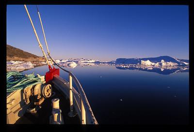 Midnight cruise through Disko Bay, west coast of Greenland.