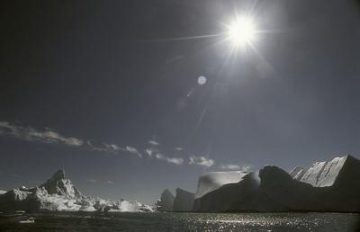 Icebergs on midnight cruise on Disko Bay, Greenland.