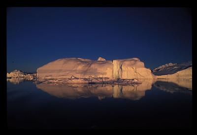 Midnight sun on iceberg, Greenland.