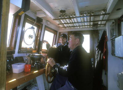 Tour boat, captain and crew on Disko Bay, Greenland.
