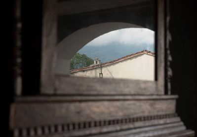 Reflection in a mirror in an old piano at a furniture repair shop, Antigua, Guatemala.