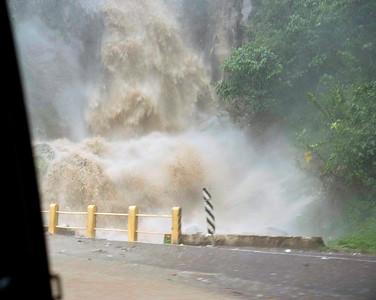 This bridge near Lake Atitlan, Guatemala, was washed away later in the day. Tropical storm Agatha, May, 2010.