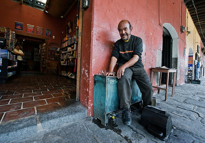 Shoe shine man at the office, Antigua, Guatemala.