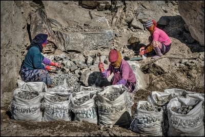 Make the big rocks ... smaller. Road work on the road to Changu (Tsomgo) Lake, Sikkim, India.