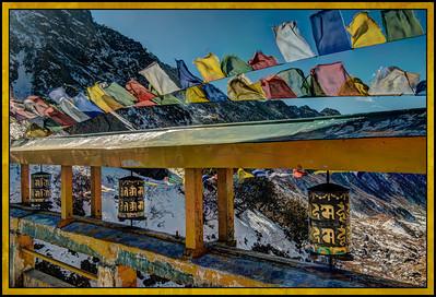 Prayer Wheels and Prayer Flags at Changu (Tsomgo) Lake, Sikkim, India.