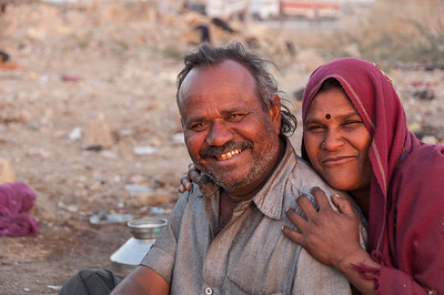 A Gypsy couple who asked to have their photo taken. Living on the ground with no cover. Seem extremely happy.