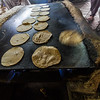 Women preparing chapattis in langar - India