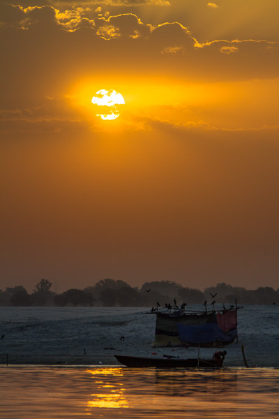View of sunset near riverbank - India