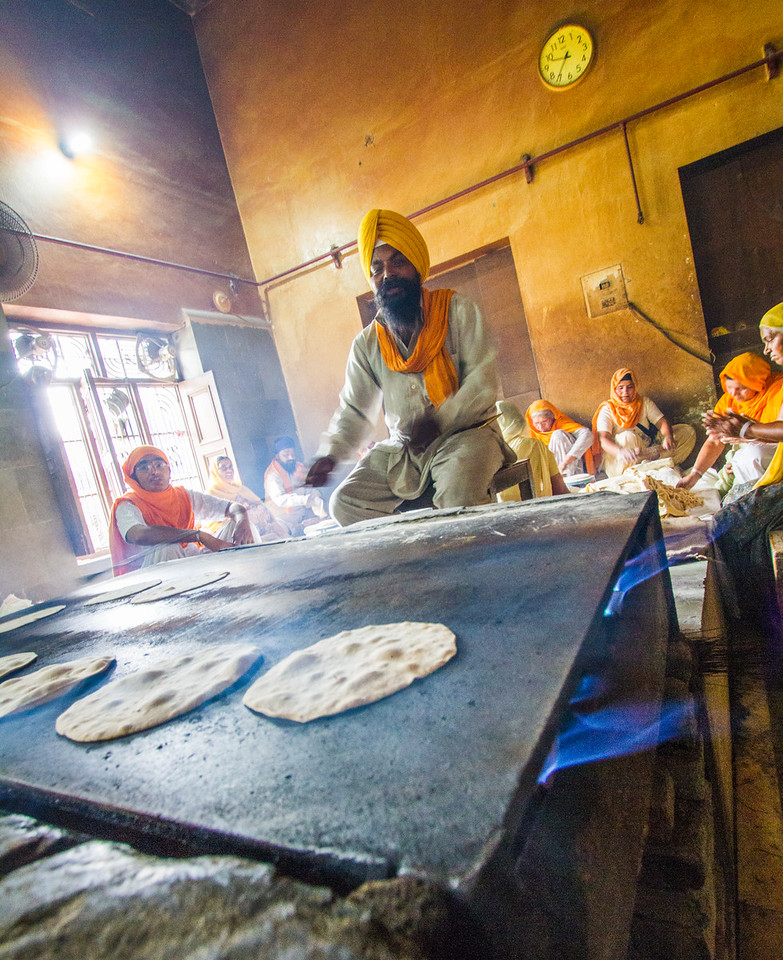Men preparing chapattis in langar - India