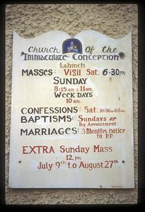 Sign on Catholic church, Lahinch, County Clare, Ireland.