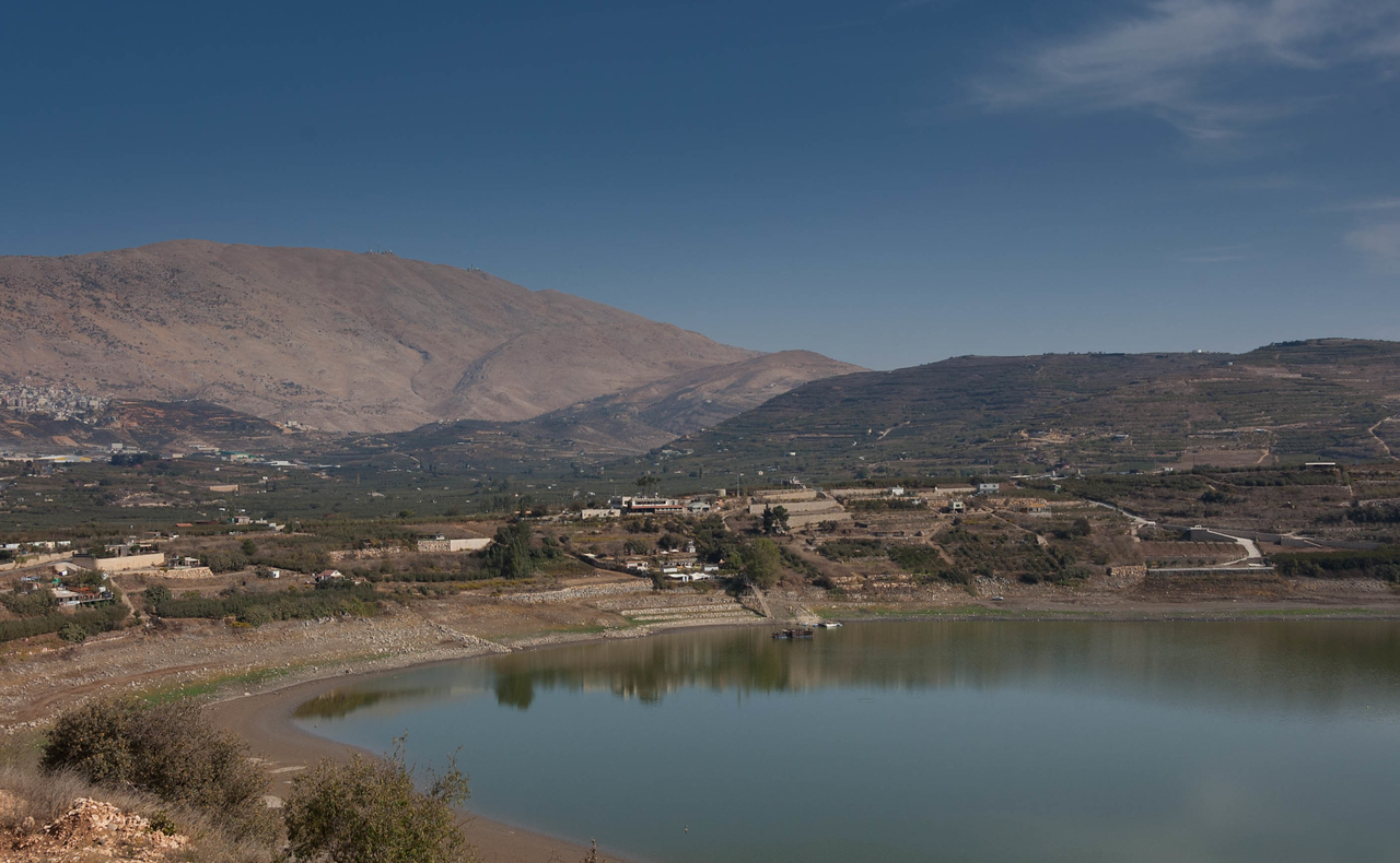 """Birkat Ram"" a crater lake with the Hermon Mountain in the background. The water does not leave this lake to any other body of water. If you look closely at the top of Mount Hermon two stations can be seen. The one on the left is an Israeli station, the one on the right is Syrian."