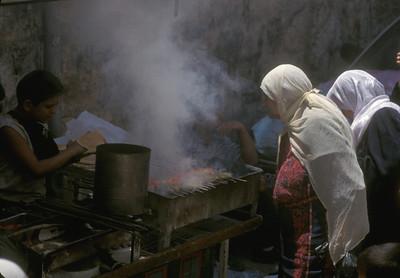 Pita and kebabs after Friday prayers, old walled Jerusalem.