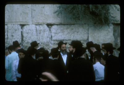 Orthodox Jewish men at the Western Wall at night, Jerusalem, Israel.