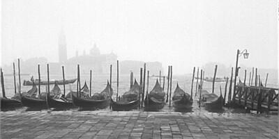 Gondolas and Cathedral di San Giorgio Maggiore, Venice, Italy.