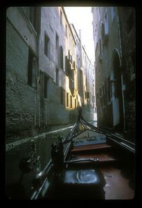 Narrow canal from gondola, Venice, Italy.