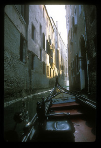 Narrow canal from gondola, Venice, Italy.