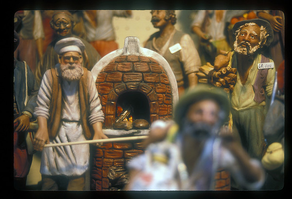 Figurines in shop window, Venice, Italy.