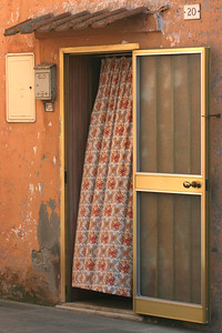 Curtain in orange doorway