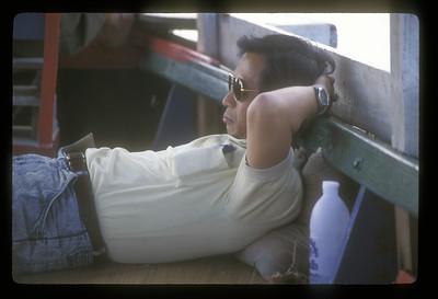 A little nap aboard ship, Laos.
