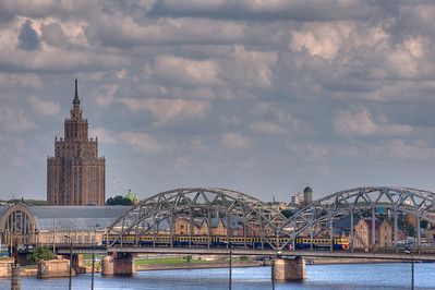 Railroad bridge over Daugava River and Academy of Sciences building, Riga, Latvia.