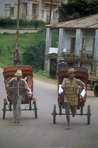 """""""Pousse-pousses,"""" local transport in Antsirabe, Madagascar."""