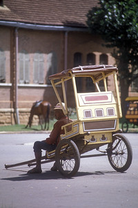 """Pousse-pousse,"" local transport in Antsirabe, Madagascar, and driver."