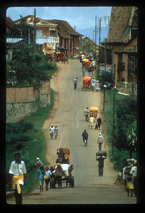 The mode of travel is the human-powered pousse-pousse in Antsirabe, Madagascar.