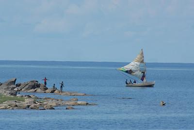 Boat with home made sail and boys, Lake Malawi.